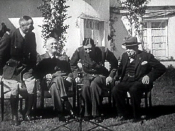 Charles de Gaulle sits down with rival Henri Giraud (left) after shaking hands with him in presence of Franklin Roosevelt and Winston Churchill at the Casablanca Conference, 14 January 1943.