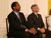 English: Dr. Benjamin Carson, left, seated with Dr. Anthony S. Fauci, listens Thursday, June 19, 2008, as he is announced as a recipient of the 2008 Presidential Medal of Freedom, at ceremonies in the East Room of the White House.
