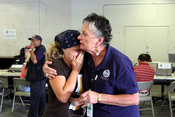 English: Houston, TX, September 19, 2008 -- A FEMA Individual Assistance Employee gives some emotional support to a victim of Hurricane Ike at the Disaster Recovery Center on the Ellington military base. FEMA opened four DRCs in Houston today. Photo by Gr