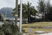 English: Pago Pago, AS, October 1, 2009 -- Pago Pago, American Samoa, October 1, 2009 - A boat that was pushed landward by the tsunami that hit American Samoa sits on its side.