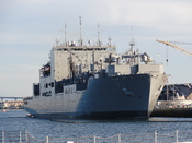 English: This is a picture of the USNS Charles Drew, docked at NAS North Island, taken from the deck of the Lord Hornblower on the way back into port.