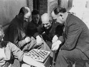 Dr. Norman Bethune (centre) watching a game of checkers / Le Dr Norman Bethune, au centre, regarde une partie de dames