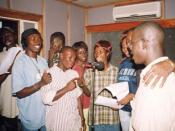 English: The cast of Atunda Ayenda a Sierra Leonean radio soap opera, showing character actors including Alhaji Sesay, third from the left, Winstinia Johnson, fifth from left, Patricia Fallah Hollist, centre by mike.