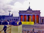 JFK receives agitprop approaching the Brandenburg Gate on 26th June 1963
