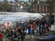 Marchers , MLK celebration (march and rally for Martin Luther King, Jr.'s birthday), Seattle, Washington. Franklin High School gymnasium in background. Sign in foreground says