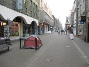 English: Rose Street Pedestrianised shopping street between Princes Street and George Street. The tent is part of a promotion by the outdoor equipment store on the left - guess why I was here. Rose Street was once notorious for its bars, and scene of an i