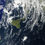 English: Image of the east coast of Sicily and of Mount Etna as it was spewing ash or steam on January 11 2011, before a lava eruption.